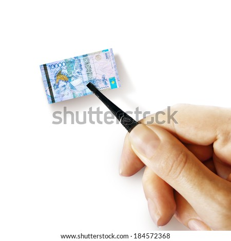 Illustration for inflation - hand with a pincer holding small banknote of Kazakhstani tenge, white background - stock photo