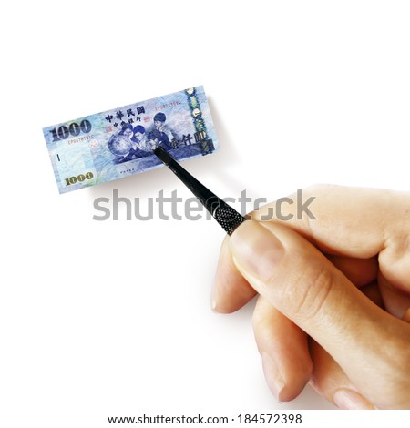 Illustration for inflation - hand with a pincer holding small banknote of Taiwan dollar, white background - stock photo