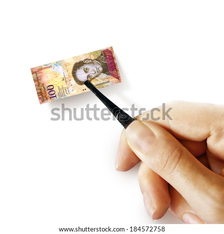 Illustration for inflation - hand with a pincer holding small banknote of Venezuelan bolivar, white background - stock photo