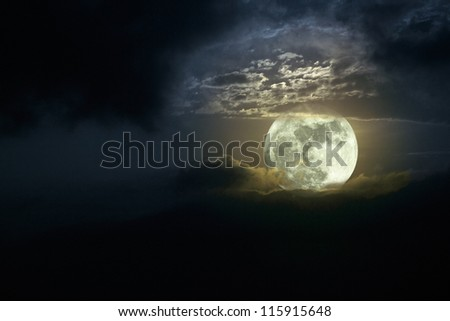 Illustration of a beautiful moonrise in a cloudy night; full moon; added some digital noise - stock photo