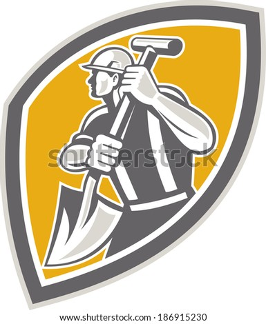 Illustration of a construction worker wearing hardhat digging using shovel spade facing side set inside shield done in retro style