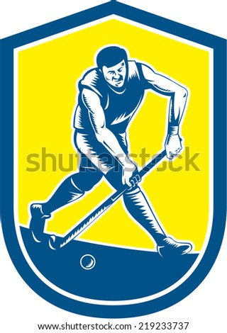 Illustration of a field hockey player running with stick striking ball set inside oval shape done in retro woodcut style on isolated background.