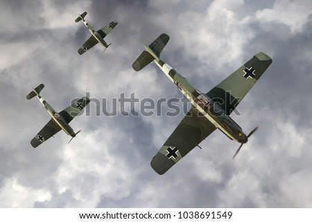 Illustration of a German fighter planes of WW2 flying above the clouds.