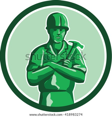 Illustration of a green plastic toy builder construction worker standing wearing hard hat holding hammer arms crossed viewed from front set inside circle on isolated background done in retro style.  - stock photo