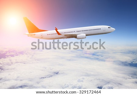 Illustration of a planet flying in blue sky over the clouds - stock photo
