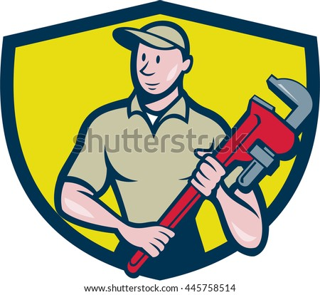 Illustration of a plumber in overalls and hat standing looking to the side holding monkey wrench viewed from front set inside shield crest on isolated background done in cartoon style. - stock photo