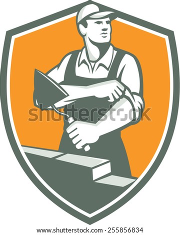 Illustration of a tiler plasterer mason masonry construction worker with trowel rolling sleeve looking to the side set inside shield done in retro style.  - stock photo