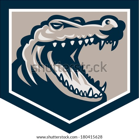 Illustration of an angry alligator crocodile head snout snapping set inside shield done in retro style on isolated background. - stock photo
