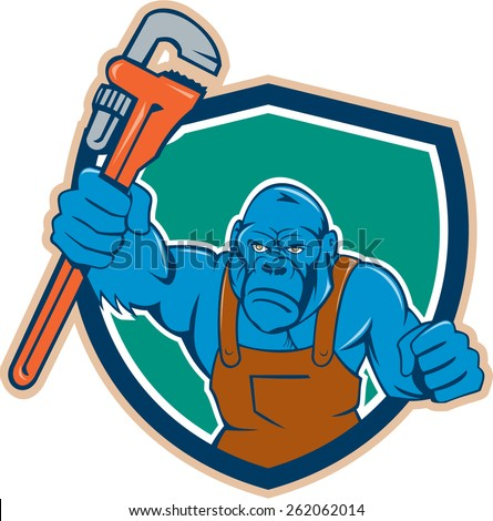 Illustration of an angry gorilla ape plumber with monkey wrench punching facing front set inside shield crest on isolated background done in cartoon style.