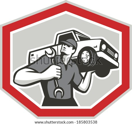 Illustration of an automotive mechanic carrying pick-up truck car vehicle on shoulder holding spanner wrench set inside shield crest shape done in retro style. - stock photo