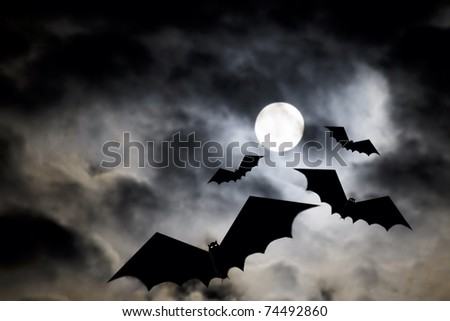 Illustration of bats flying on a scary evening - stock photo