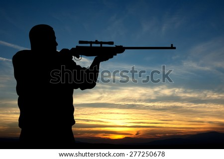 Illustration of hunter silhouette on sunset background