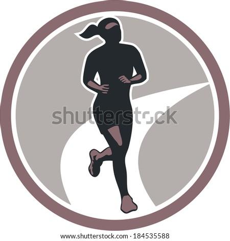 Illustration of marathon triathlete runner running winning finishing race set inside circle on isolated background done in retro style. - stock photo