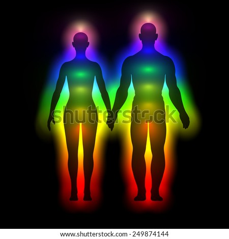 Illustration of rainbow silhouette of woman and man with aura - stock photo