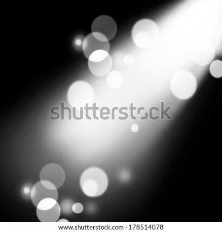 illustration of spotlight with glowing snow - stock photo