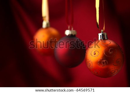 illustration of three Christmass ball on red background