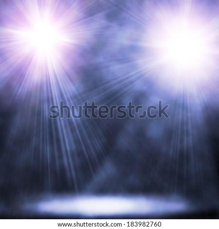 illustration of two blue spotlights - stock photo