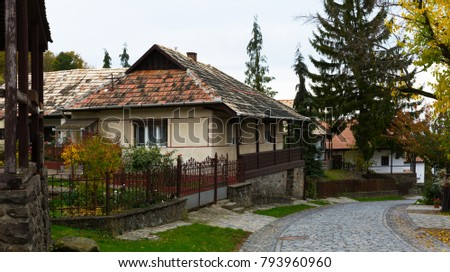 Illustration of view on the streets of traditional hungarian village Holloke outdoor.