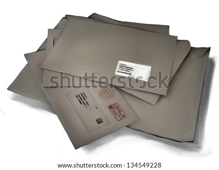 Illustration representing a stack of messy closed brown paper mail envelopes isolated on a white background - stock photo