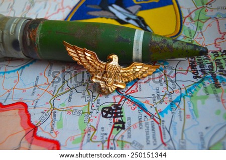 Illustrative editorial.Cockade of Ukrainian air force. Estern Ukraine map with site MH-17 flight crush as background. At January 10,2015 in Kiev, Ukraine - stock photo