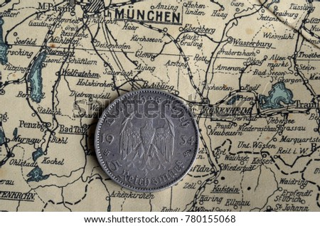 ILLUSTRATIVE EDITORIAL.German vintage coin.Background - German vintage map of Central Europe circa 1944 fragment. Kiev,Ukraine December 22 ,2017