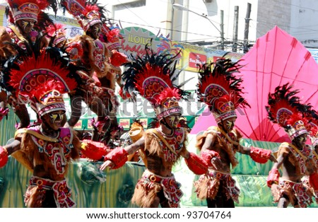 ILOILO, PHILIPPINES –JAN. 22: Street dancers showcase Filipino culture & tradition in Dinagyang Fiesta on January 22, 2012 in Iloilo southern part of the Philippines. - stock photo