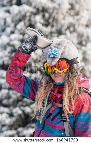 Image brave adventurers engaged in skiing and snowboarding - stock photo