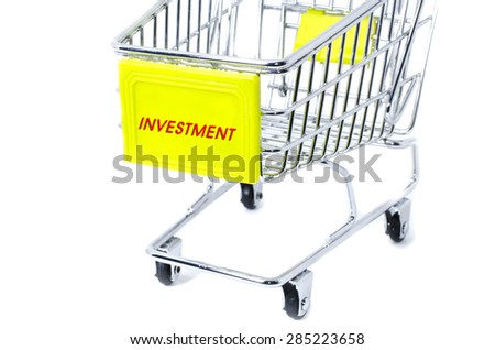 image concept cropped trolley with word investment isolated white background - stock photo