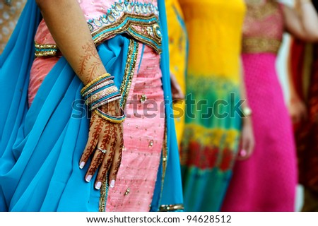 Image detail shot of henna tattoo and saris - stock photo