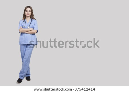 Image Doctor trainee on the background of the large windows, the background doctor's office, a woman with dark hair and a sweet smile - stock photo