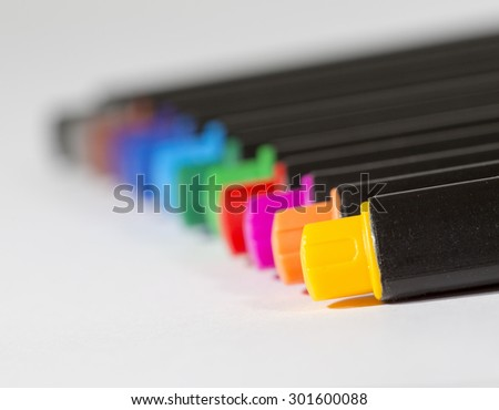 Image for Back to school theme. An image of colorful pencils against a white page.