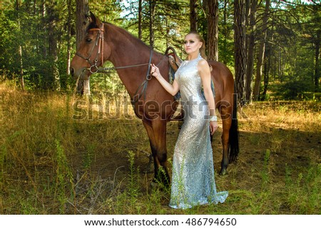 Image girl in a beautiful dress is a horse
