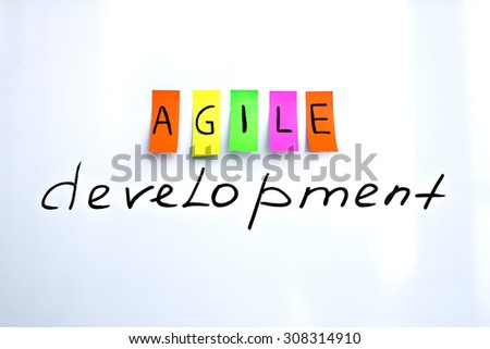 Image inscriptions of agile development. Agile methodology writing colors stickers isolated on white background of white board.