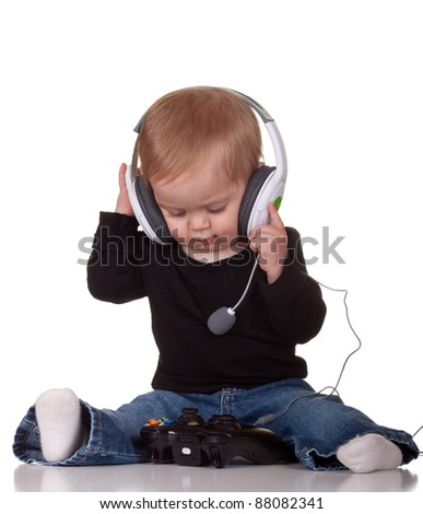 Image of a baby playing video games. - stock photo