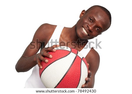 Image of a basketball player with ball looking at camera - stock photo