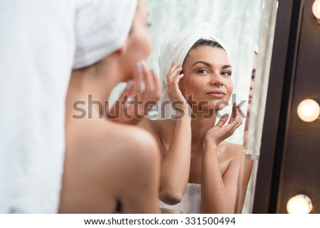 Image of a beautiful content woman pampering her skin - stock photo