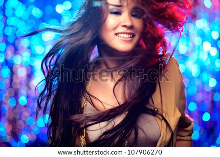 Image of a beautiful female dancer in motion - stock photo