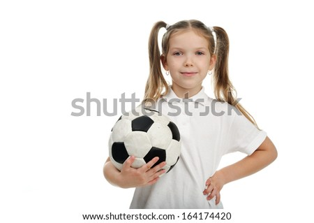 Image of a beautiful girl holding a ball. - stock photo