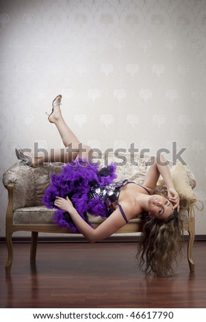 Image of a beautiful girl on a luxurious couch - stock photo