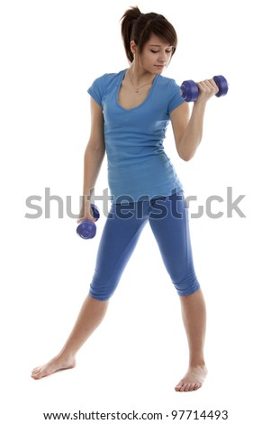Image of a beautiful girl with dumbbells