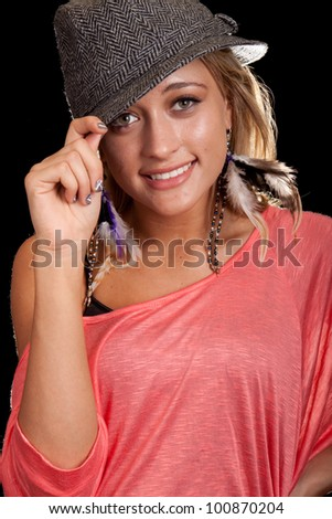 Image of a beautiful girl with rim lighting. She is wearing a hat.