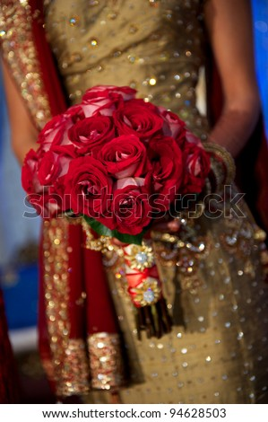 Image of a beautiful Indian bride's bouquet during wedding - stock photo
