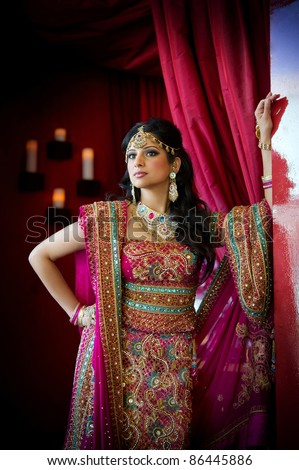 Image of a beautiful Indian bride standing - stock photo