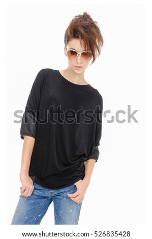image of a beautiful woman in jeans with sunglasses in studio. Hairstyle