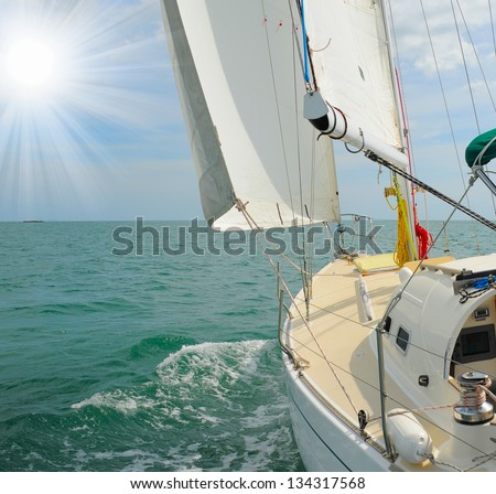Image of a beautiful yacht in the open sea on a sunny day