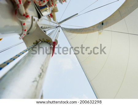 Image of a beautiful yacht in the open sea on a sunny day - stock photo
