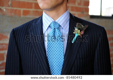 Image of a Blue Pinstriped Suit with Tie and Boutonniere - stock photo