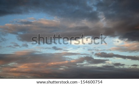 Image of a blue sky with orange clouds.