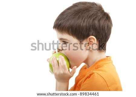 Image of a boy eat the apple - stock photo