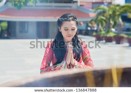 Image of a buddhist woman praying in the temple - stock photo